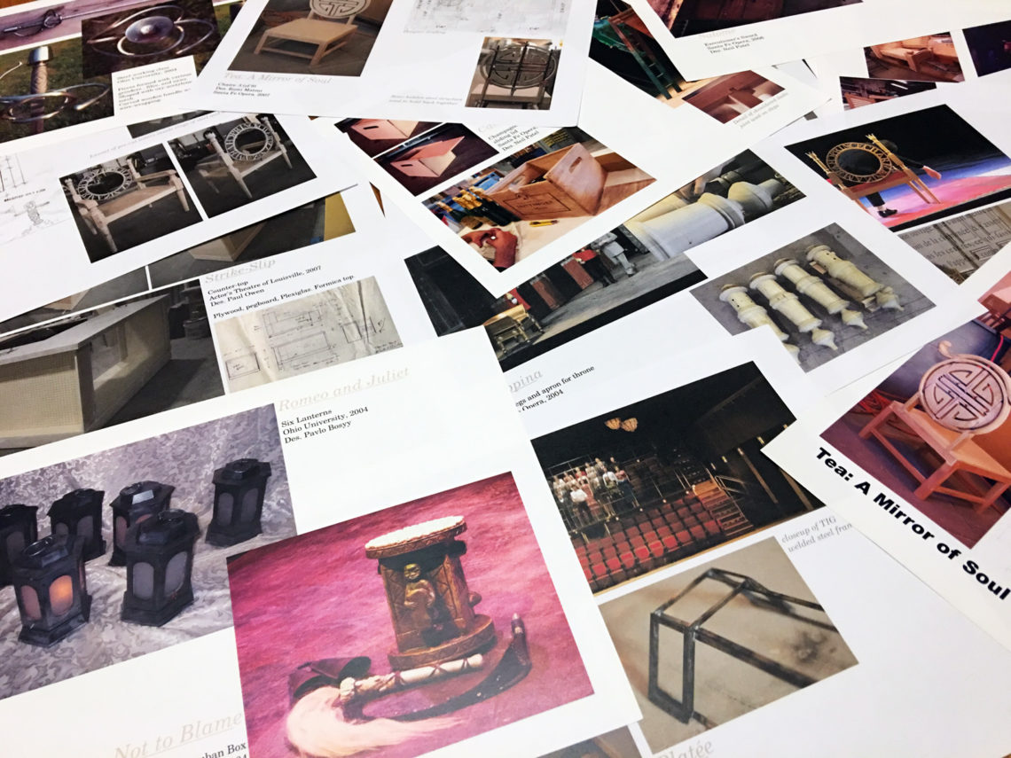 pages from a portfolio scattered over the floor